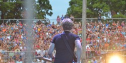 A view from behind the stage, of Hunter Hayes looking over the crowd.