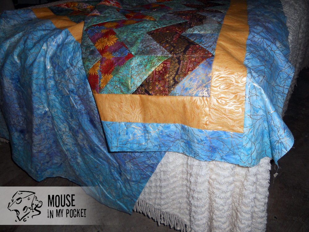 detail of shiny chevron quilt top
