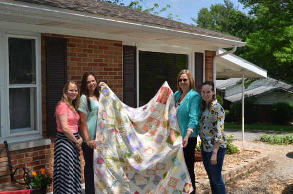 Mom, sisters and I with the quilt